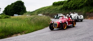 PESARO, ITALY - MAY 15: unidentified crew on an old racing car in rally Mille Miglia 2015 the famous italian historical race (1927-1957) on May 15, 2015