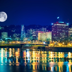 Portland Skyline with Moon and the Willamette River. Downtown Portland Oregon United States.