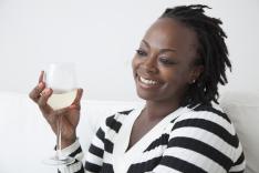 Black woman drinking white wine